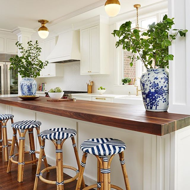 Beautiful traditional white kitchen. Blue, white, brass, and butcher block.