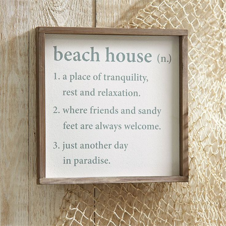 "Our Beach House Sign is the perfect accessory for your home or summer home. The sign features a wood plaque with raised thick wood border and a printed beach house ""definition."" Arrives with saw tooth"