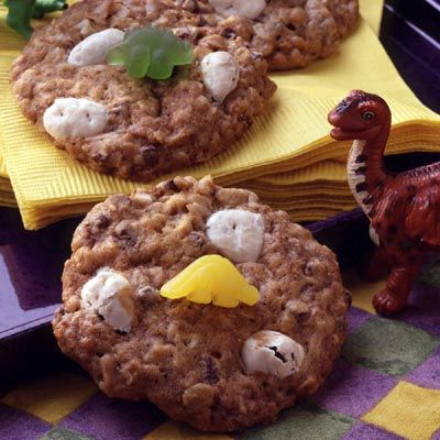 """Spoiler: Yogurt-covered raisins are the secret to creating the """"dino eggs"""" in these chocolate-oatmeal cookies. Get the recipe.    - Delish.com"""