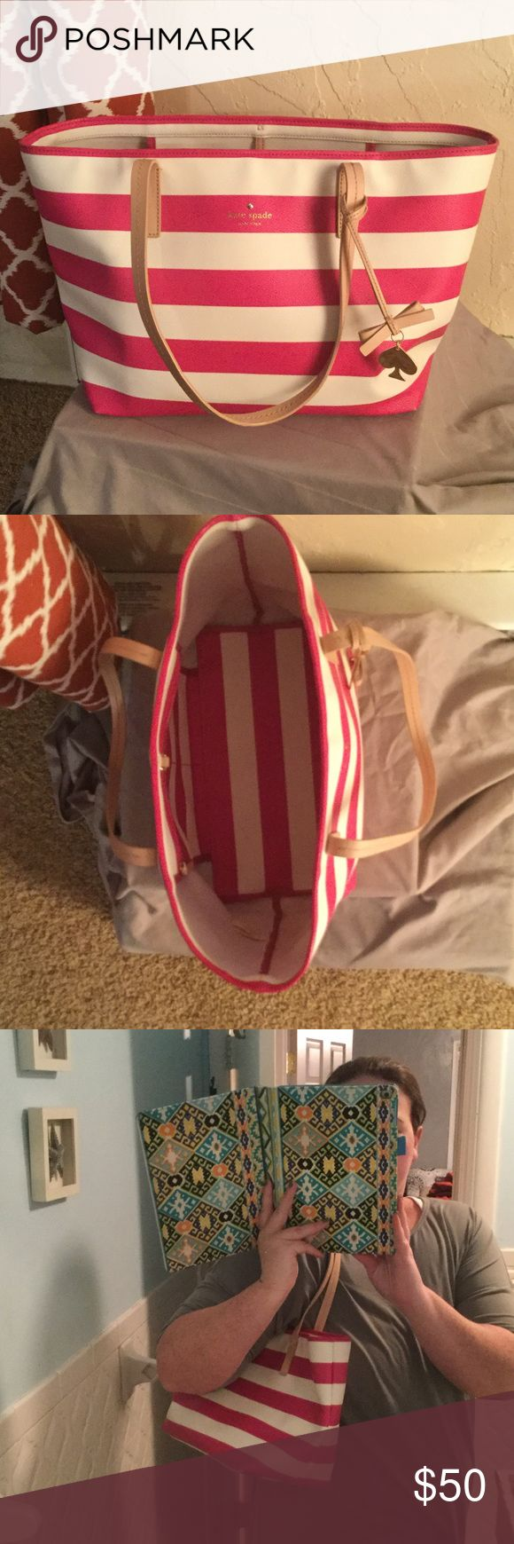 Pink/White Kate Spade Shoulder Bag Kate Spade Pink and White Striped Shoulder Bag. Used but in great condition. Has some pen marks on the inside bottom. kate spade Bags Shoulder Bags