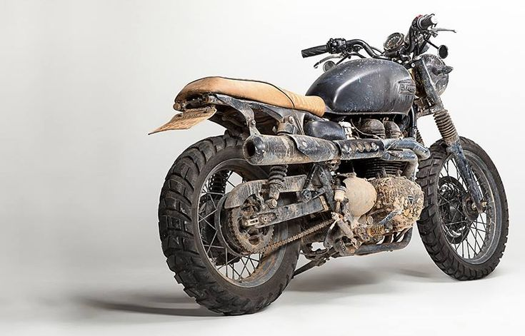 """David Beckham's custom Bonneville T100 captured in the studio after a grueling adventure in the Amazon.:"""