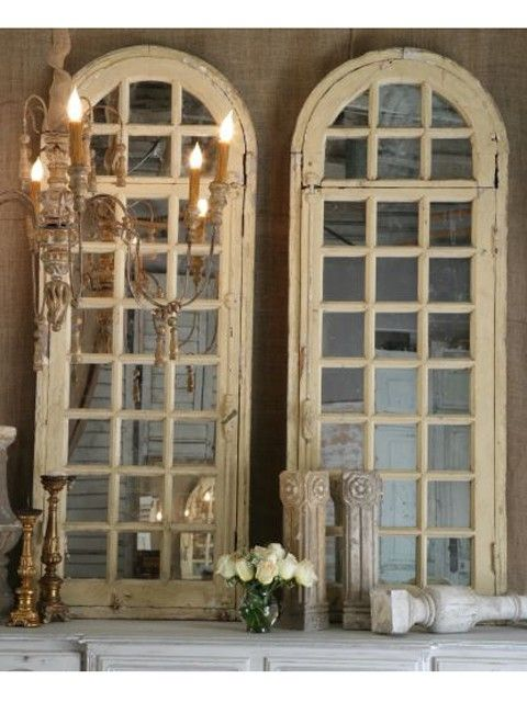 Old window frames repurposed over mirrors. This would look fantastic on a fireplace mantle with some fresh greenery.