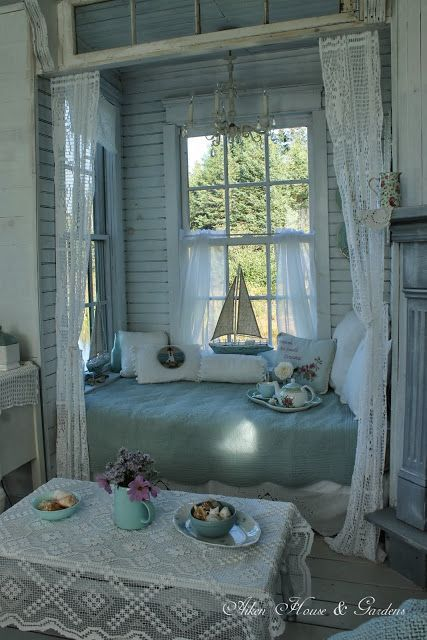Beach house nook..the window above bed, the curtains for sleeping privacy, the colors, the chandelier