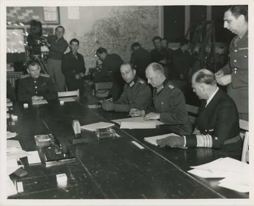 The signing of Germany's unconditional surrender, ending the European spoke of WWII. (May 7, 1945): Time, Germany S Unconditional, 1945 V E, Homefront Daddy Wwii, Ii Europe 1945