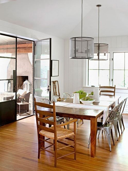 How to Modernize Your Dining Room Industrial chairs and wire pendants bring cool metals tones to this farmhouse dining room dominated by wood surfaces, and their presence gives it contemporary appeal.