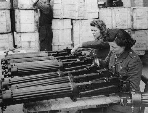 Women in the ordnance depot in England check a new shipment of Vickers machine guns that just arrived from the United States as part of Lend Lease, 1940