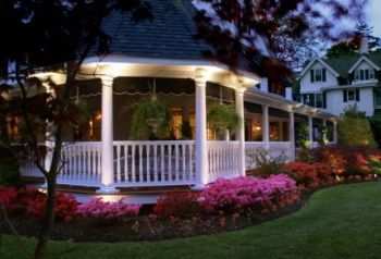 wraparound porch with curb appeal.