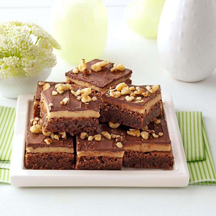 """Cookie Dough Brownies Recipe -When I take these rich brownies to any get-together, I carry the recipe, too, because it always gets requested. Children of all ages love the tempting """"cookie dough"""" filling. This special treat is typically the first to be gone from the buffet table—even before the entrees! —Wendy Bailey, Elida, Ohio"""