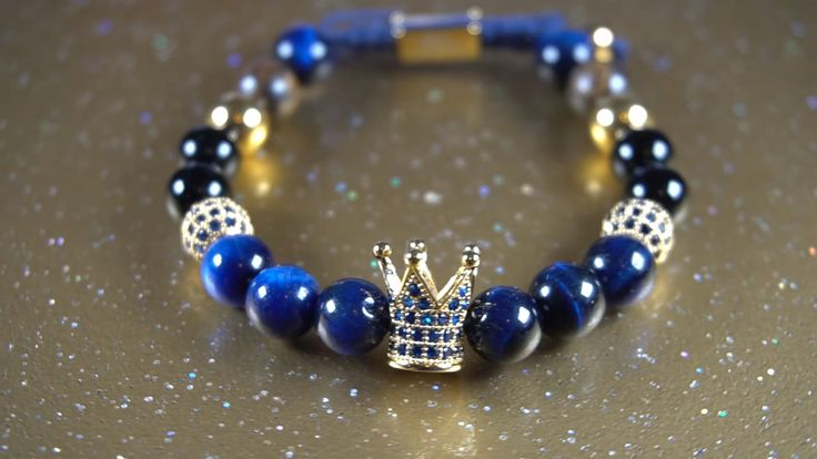Royal Crown is an amazing bracelet , crafted with 6mm blue , black and brown natural stones , one gold crown 7mm charm with CZ stone , 2 beads 6mm charms with CZ stone and 2 gold 6mm beads . Custom sizing available for your perfect fit . PREMIUM QUALITY • 100% HANDMADE . Comes with a polished Gentil Style gift box .