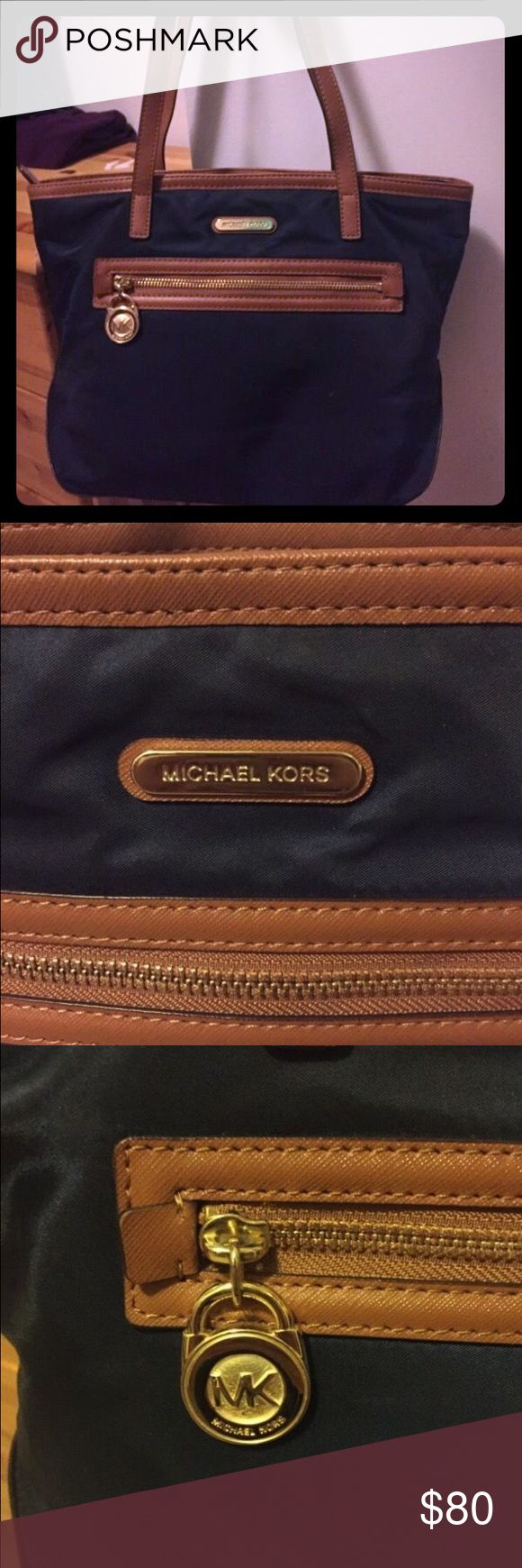 Michael Kors Kempton Navy Purse This is a Michael Kors purse in navy and brown. It is a medium sized shoulder bag. In great condition!! MICHAEL Michael Kors Bags Shoulder Bags