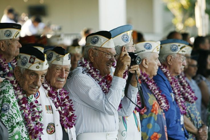 December 7, 2013: Pearl Harbor survivor Ewalt Schatz takes a picture at a ceremony commemorating the 72nd anniversary of the Japanese WWII attack. - Found via Buzzfeed
