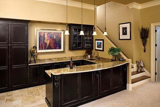 Consider including a full bar in the rec room if you have a finished basement. This is the bar from the Oak Abbey, plan 5003 www.dongardner.com. #Bar #RecRoom #Basement