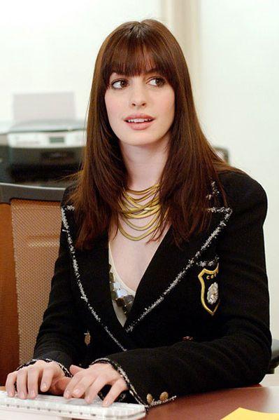 Anne Hathaway in the Devil wear Prada finally blending in with Emily wearing a Chanel jacket