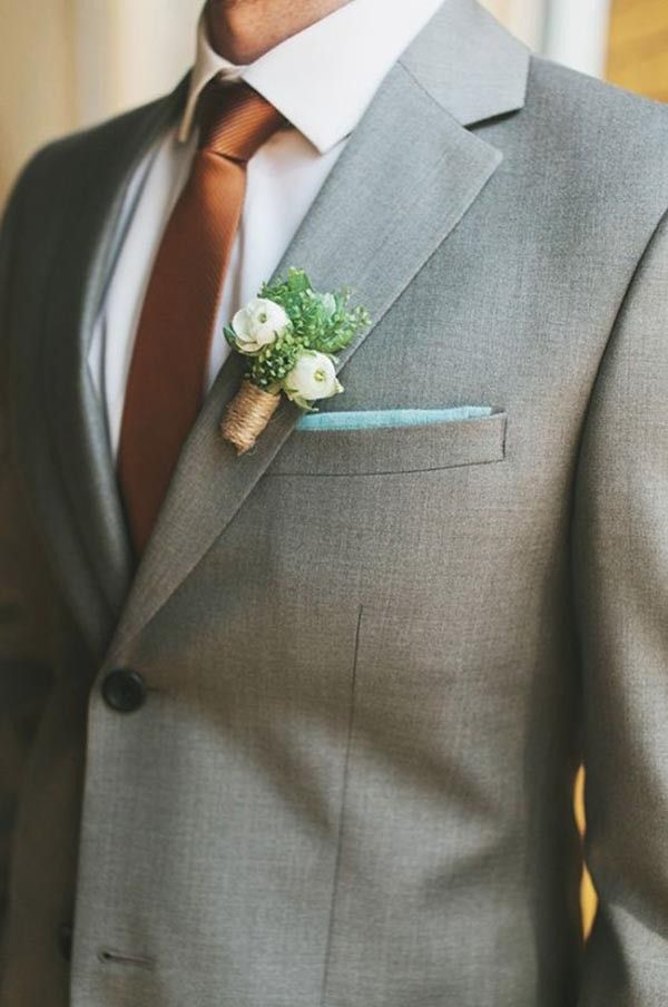 Groom with grey suit and copper tie. See more of this metallic trend here: http://www.mywedding.com/articles/copper-wedding-details/