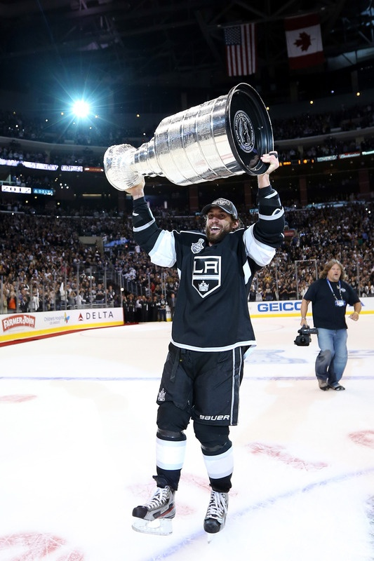 Jarret Stoll #28 Of The Los Angeles Kings Holds up the Cup