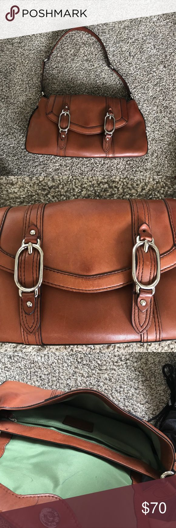 Cole Haan Brown Shoulder Purse This Cole Haan bag is perfect for everyday use.  It is used and is missing one stud on the front, as pictured, but is otherwise in good condition. It has one zippered pocket on the inside. Cole Haan Bags Shoulder Bags