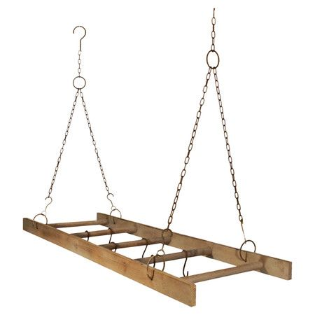 Metal and wood hanging pot rack with a ladder design. Product: Pot rackConstruction Material: Metal and wood
