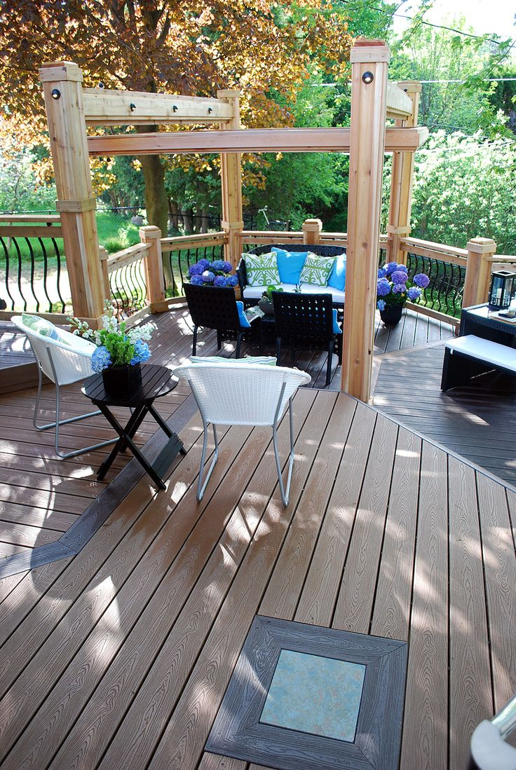 this inviting lounge area features a chunky pergola and decorative
