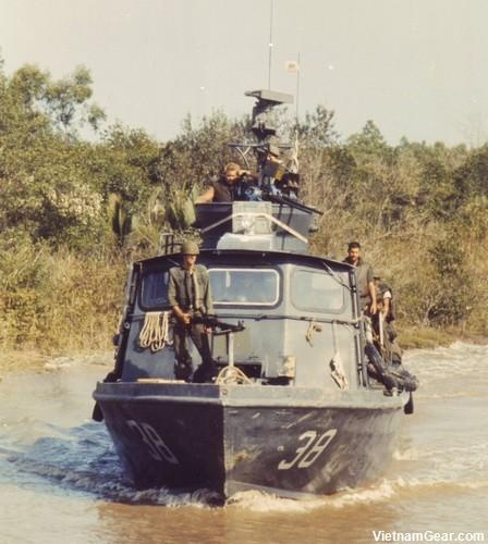 U.S. Navy Fast Patrol Craft (Swift Boat) PCF-38 of Coastal Division 11 cruises the Cai Ngay Canal.    Photo taken: April 1970