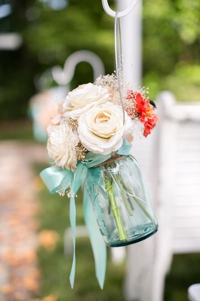Simple wedding ceremony aisle marker - blue-tinted mason jars filled with flowers {Ardent Story Photography}