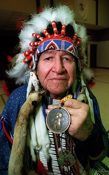 Paha Ska, of Keystone, S.D., an Elder of the Oglala Sioux tribe from the Pine Ridge Reservation in South Dakota, holds an original Indian Peace Medal that were given out by the Lewis and Clark Expedition to Native American leaders between 1804-06.