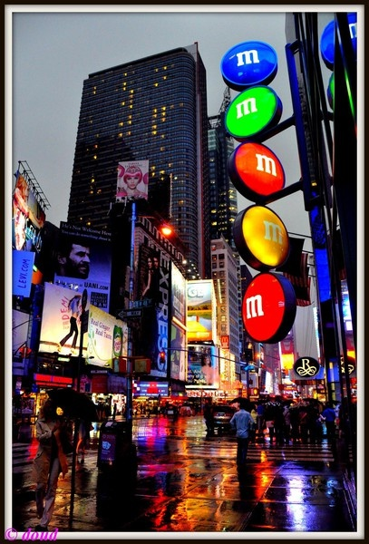time square is a famous intersection in New York know for its cool attractions,shops,cinema and electronic billboards. It's the most brustling square of New York.
