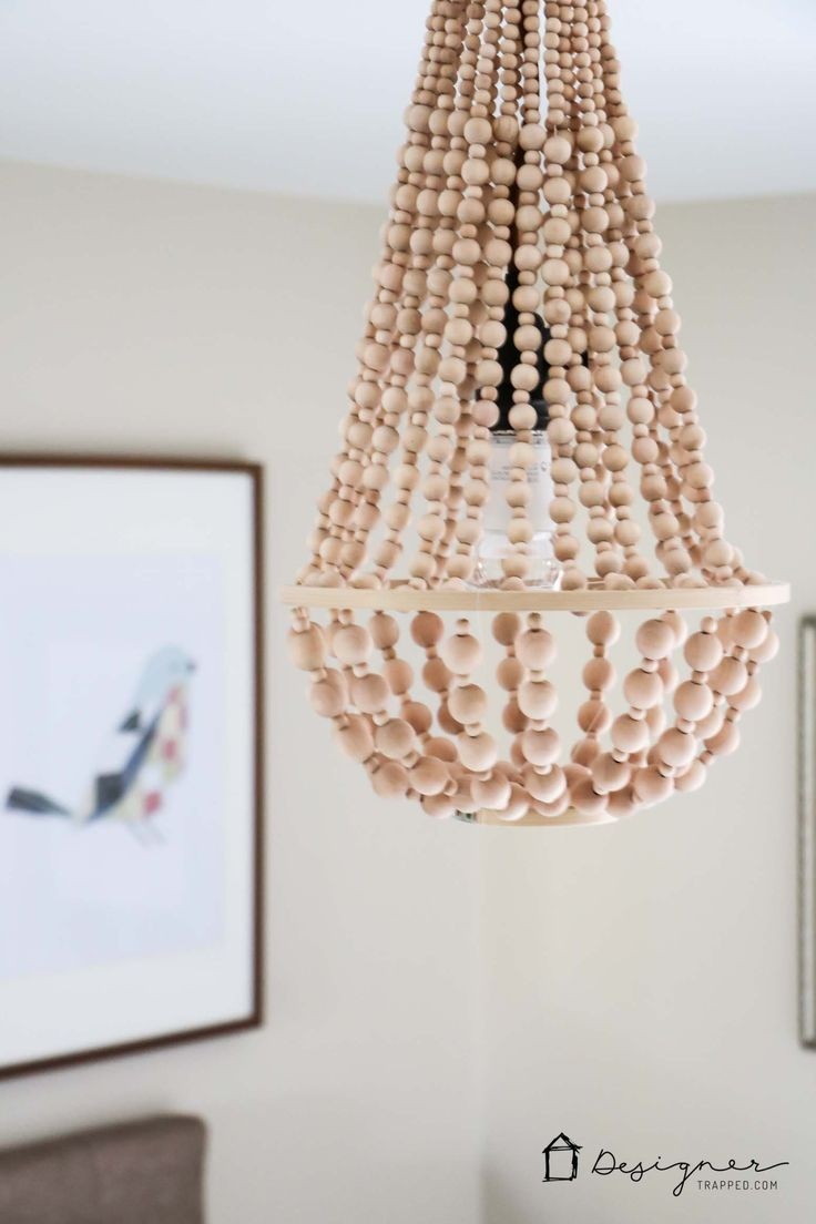 The 25 best wood bead chandelier ideas on pinterest bead diy chandelier from wood beads mozeypictures Image collections