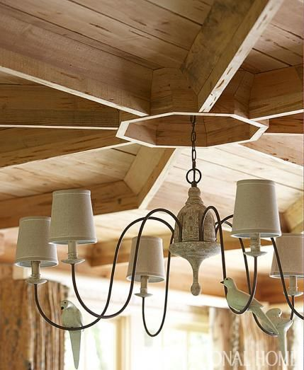 At the center of a coffered ceiling this chandelier with a little bird adds a