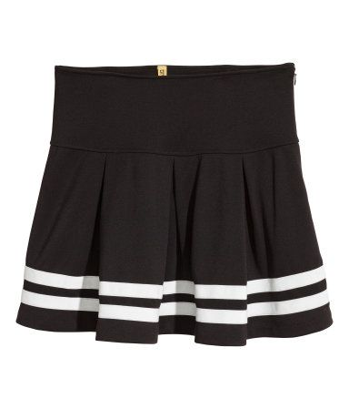 Black. Short jersey skirt with a wide,double-layer waistband, concealed zip at side, and velour trim at hem. Unlined.