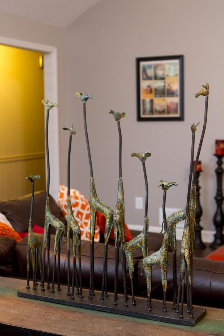 LIVING ROOM, AFTER: Fun decor items like this giraffe sculpture add character to the living room after a renovation by the Property Brothers.