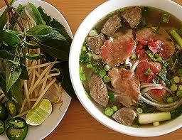 Combination Pho w/Thai basil, lime, jalapeno and bean sprouts. Egg Roll #1 is the best place to get it. Yum!
