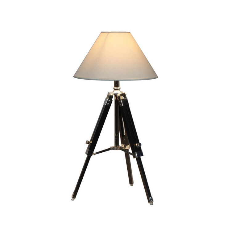 This Navy Tripod Table Lamp is crafted of solid pine wood with stainless steel accents.The shade is made of fabric and the lamp head can be positioned up or down. The light fabric of the shade is innovation at its finest, turing the standard of the classic see through shade on its head. Give off a soft glow through the light interwoven thread, or tilt the shade back to provide a full stream of heavy light. Either way you place this nautical design you are sure to inspire a relaxing…