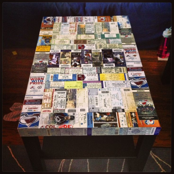 I took old event tickets and pasted them to a cheap coffee table and side tables. Once I no longer need these tables, I can take the legs off and hang them on my walls as art.