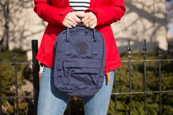 Abisko lite Jacket in red from Fjallraven Canada, re-kanken Mini backpack in navy, blue and white striped shirt from J.Crew, jean machine jeans, black suede booties