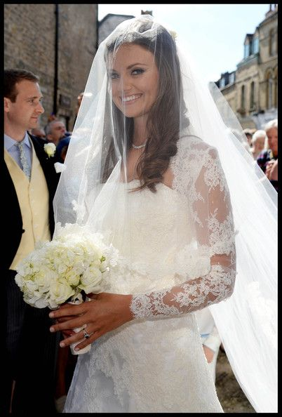 Lady Natasha Rufus Isaacs arrives for her wedding to Rupert Finch at the Church of St. John the Baptist