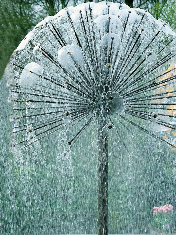 Multi Level Water Feature Creates Visual Interest. For more amazing garden water features, visit http://www.greensquares.co.uk/