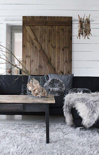 charcoal grey & white swedish style living room with fur rug & throwand velvet cushions