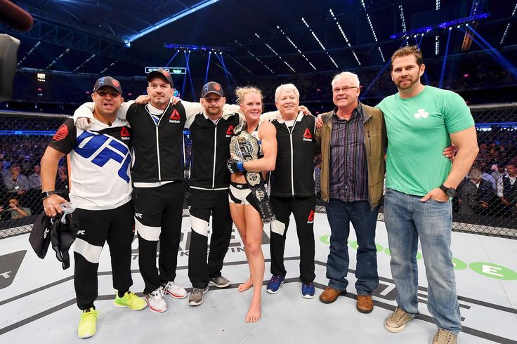 And the new: Holly Holm celebrates with her trainers and family after defeating Ronda Rousey at UFC 193