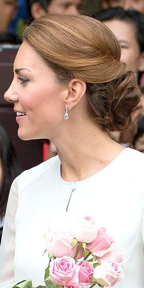 Kate Middleton models a perfect, elegant #fall #wedding hairstyle: a twisted low bun secured with pins and hairspray. Get easy hairstyle tips at: http://www.esalon.com/blog/5-minute-hairstyling-tricks/