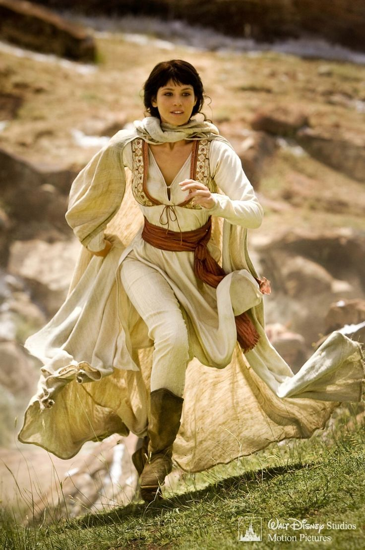 Princess Tamina from Prince of Persia.  She has bangs, she's wearing cool clothes and she's running through the hills on an adventure....I'm jealous.