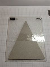 Partial Embossing- This is brillant and so much easier than dealing with cardboard shims. The triangle is taped to the outside of the plate and that is the ONLY portion that is embossed!