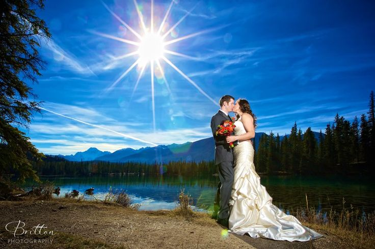 Bride and Groom stunning photo in Jasper, Alberta. Photo by Britton Photography.