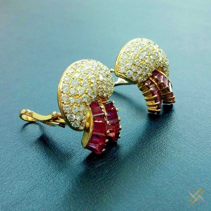 K18 Gold with brilliants and real Rubies