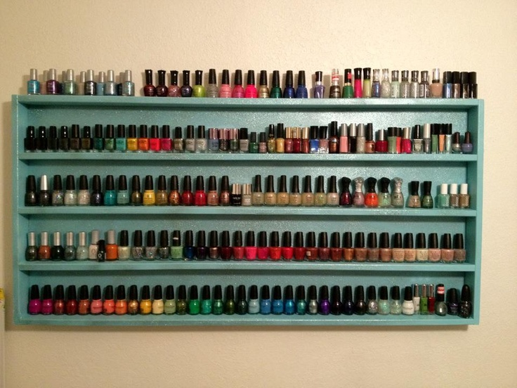 """Nail polish wall shelves. Three 1""""x3""""x8's. Two of them cut in half, one of them cut into half with one of the halves then cut into half again. One 2' x 4' hardiboard for the backing. Gorilla glue & wood screws, then primer & spray paint. <3"""
