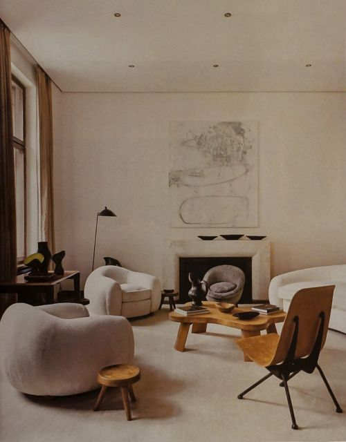 scandinaviancollectors:The apartment of Emmanuel de Bayser in Berlin, featured in Elle Deco Italia, December 2014: Jean Royère L´Ours Polaire sofa group (1949), Jean Prouvé Antony chair (1954). Photography by Mark Seelen & Francesco Marchesi. / Elle Decor Italia