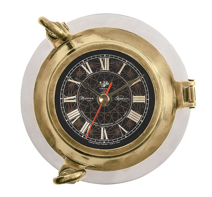 "CaptJimsCargo - Ship's Porthole Clock 6"" Bronze Finish Solid Aluminum Nautical Wall Decor,  (http://www.captjimscargo.com/authentic-models-home-decor/time-tide-clocks/ships-porthole-clock-6-bronze-finish-solid-aluminum-nautical-wall-decor/) The porthole surrounding the clock has a bronze finish. Signature Authentic Models branded black clock dial face."