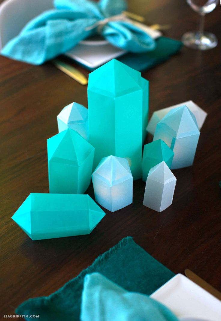 After you trim the templates, use the dotted score lines as a guide for folding the paper to form the crystal shapes. Some of the origami gems have ...