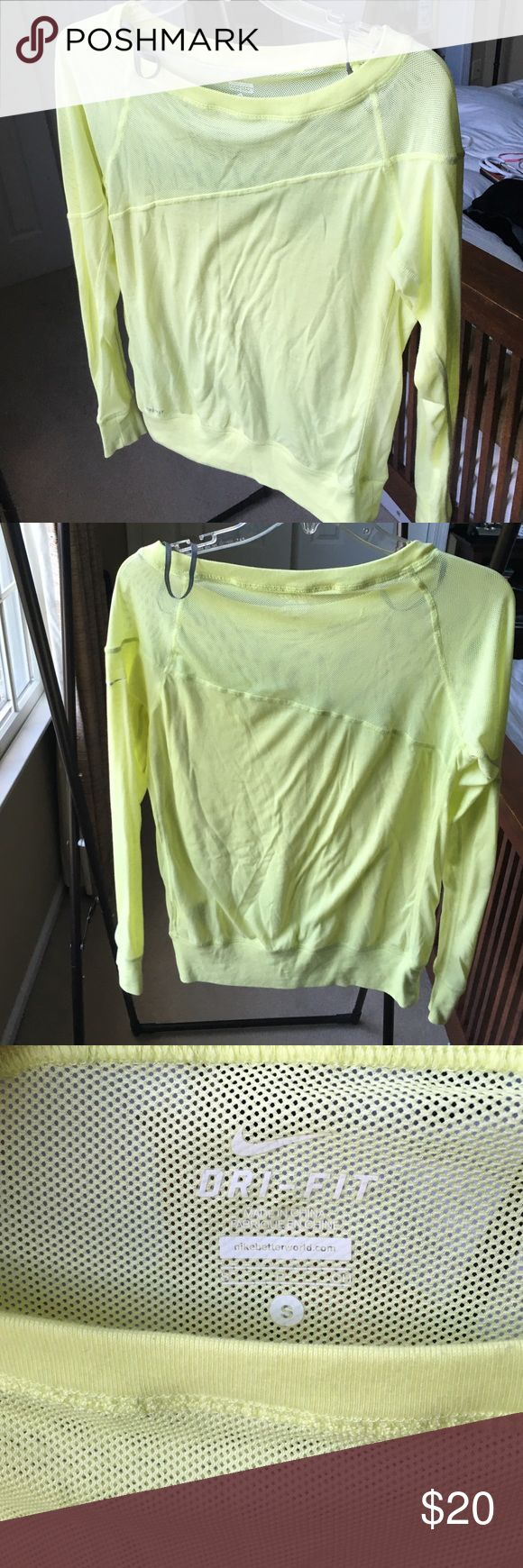 Nike Dry Fit workout top You can't miss this Neon colored workout top. Nike dry fit technology. Mesh top with asymmetrical hem across front and back. Fabric is 75% polyester 13% cotton and 12% rayon. Great condition! Back of shirt top right there is a gathering of the mesh stitch, but that was there when I bought it Nike Tops Tees - Long Sleeve
