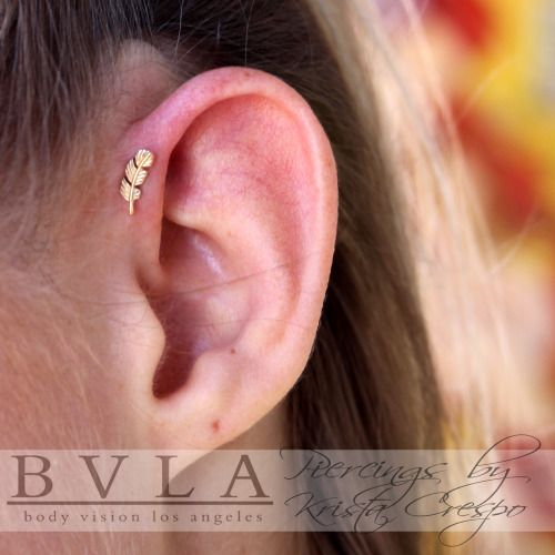 piercedbykarma:Fresh single forward helix piercing with a beautiful 14k yellow gold threadless feather from @bvla for this savvy lady! @tattooboogaloo