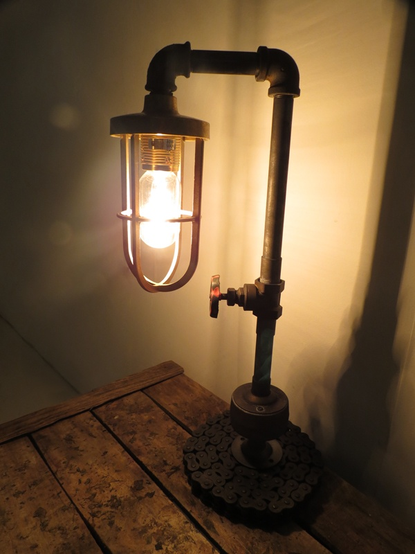 Galvanised Pipe Table Light With A Caged Fitting & Element Lamp http://www.chantellelighting.co.uk/products-page/lighting/industrial/industrial-table-floor/035964-2/